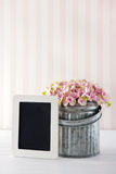 Pink hydrangea flowers with empty blackboard Royalty Free Stock Photos