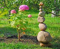 Pink hydrangea with a stone pyramid Stock Photo