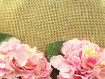 Pink Hydrangeas Artificial flowers on decorative tablecloth on sacking background space and composition Royalty Free Stock Photography