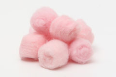 Pink hygienic cotton balls. Isolated on a white background Royalty Free Stock Images