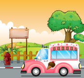 A pink ice cream bus and an empty board Stock Photo