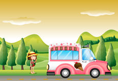 A pink ice cream bus and the little girl Stock Image
