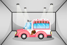 A pink ice cream car inside the garage Stock Photography