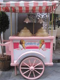 Pink ice cream handcart. Very pretty and colorfull selling icecream in the middle of the street in Italy Stock Images