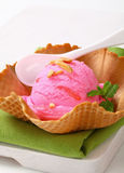 Pink ice cream in a wafer bowl Stock Photos