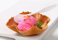 Pink ice cream in a wafer bowl Stock Images