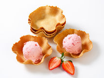 Pink ice cream in waffle baskets Royalty Free Stock Images
