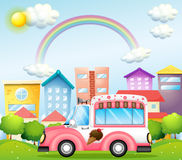 A pink icecream bus in the city Stock Images
