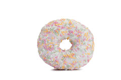 Pink Iced Doughnut covered in sprinkles isolated Stock Photos