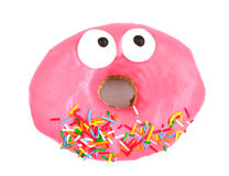 Pink Iced Doughnut. Covered in sprinkles on a white background Royalty Free Stock Photos