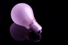 Pink idea bulb Stock Photography