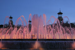 Pink illuminated fountain in the evening light of Barcelona Royalty Free Stock Images