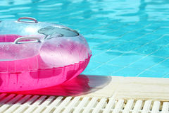 Pink inflatable round tube. In swimming pool stock image