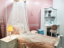 Children`s room with four-poster bed. Pink interior of children`s room with four-poster bed Royalty Free Stock Photography