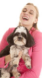 Pink jacket woman laugh dog Stock Image