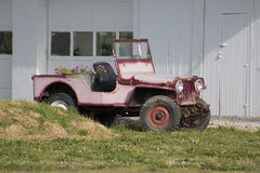 Pink jeep. An interesting pink jeep with flowers Royalty Free Stock Photography