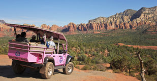 A Pink Jeep Tour Descends Broken Arrow Trail Stock Image