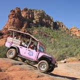 A Pink Jeep Tour Descends Broken Arrow Trail Stock Photography