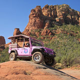 A Pink Jeep Tour Descends Broken Arrow Trail Royalty Free Stock Photo