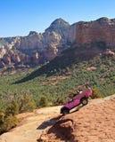 A Pink Jeep Tour Descends Broken Arrow Trail Stock Image