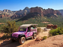 A Pink Jeep Tour Descends Broken Arrow Trail Royalty Free Stock Images