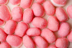 Pink jellies or marshmallows as background royalty free stock image