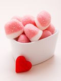 Pink jellies or marshmallows with sugar in bowl Stock Photos