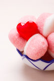 Pink jellies or marshmallows with sugar in bowl Royalty Free Stock Photos
