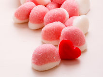 Pink jellies or marshmallows with sugar on table Stock Image