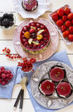 Pink jelly on silver plate with fruit pie nearby Royalty Free Stock Image