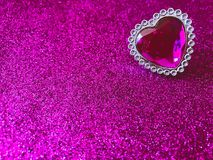 Pink jewel heart on glitter background stock photos