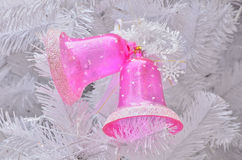 Pink jingle bell on christmas tree Stock Photography