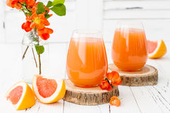 Pink juicy homemade grapefruit cocktail with alcohol over old vintage wooden table Royalty Free Stock Image