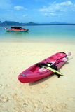 Pink kayak on the beach. A pink kayak ready for launching on the beach, overlooking a clear blue ocean Stock Image
