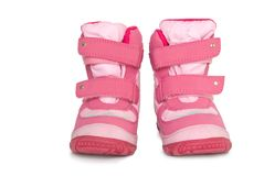 Pink kid's warm boots Royalty Free Stock Photos