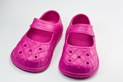 Pink kid shoes Stock Photos