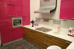 Pink kitchen. Wineglasses candle gas Royalty Free Stock Photos