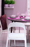 Pink kitchen. Table served at the home stock photography