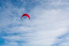 Kitesurfing sail sky. Pink kitesurfing sail on the winter sky in Mallorca, Balearic islands, Spain Royalty Free Stock Image