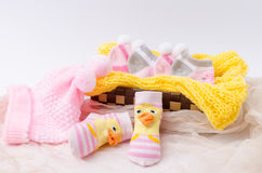 Pink knit hat and socks gift set for a newborn baby girl Stock Images