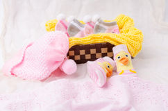 Pink knit hat and socks gift set for a newborn baby girl Stock Photos