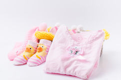 Pink knit hat and socks gift set for a newborn baby girl Royalty Free Stock Photo