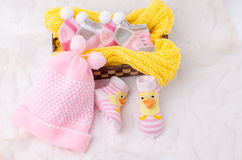 Pink knit hat and socks gift set for a newborn baby girl Royalty Free Stock Photos