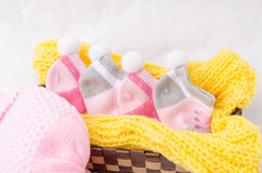 Pink knit hat and socks gift set for a newborn baby girl Stock Image