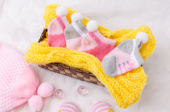 Pink knit hat and socks gift set for a newborn baby girl Royalty Free Stock Images