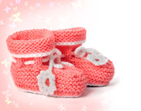 Pink knitted baby booties Royalty Free Stock Photos