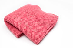 Pink Knitted Blanket. Pink baby blanket on White Background Royalty Free Stock Photography