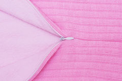 Pink knitted fabric with opened zipper Royalty Free Stock Image