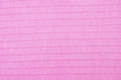Pink knitted fabric texture Stock Image