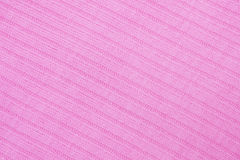 Pink knitted fabric texture Royalty Free Stock Images